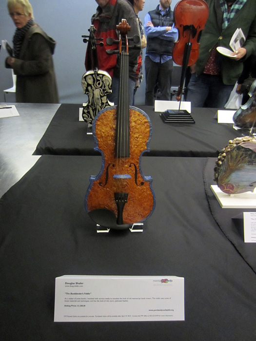 donated painted violin by Doug Shafer at the unveiling and concert at Weiden & Kennedy Portland